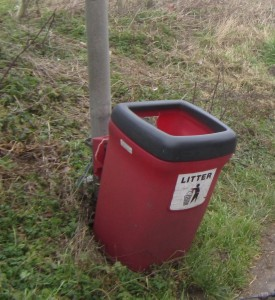 The broken bin by the bus stop on the A47, Norwich bound direction.