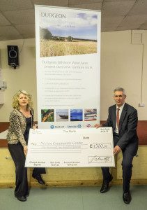 Cllr Sisto and the Parish Clerk, with the cheque received from Dudgeon Wind Farm.